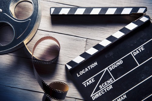 Movie slate and film reel