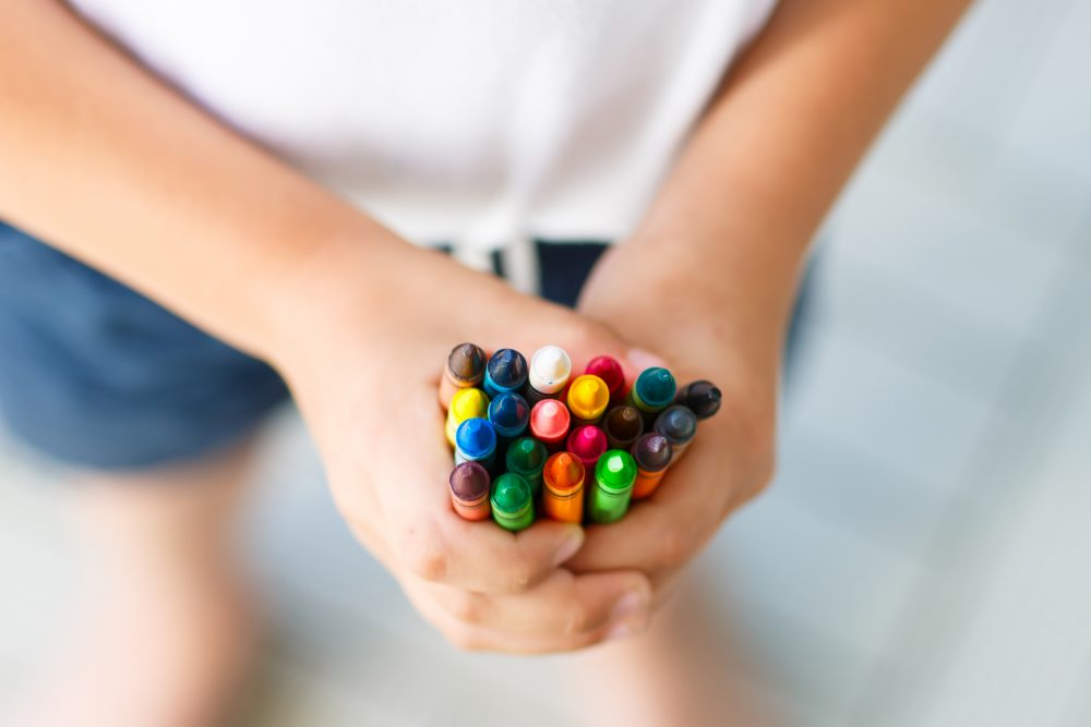 Crayons in child's hand